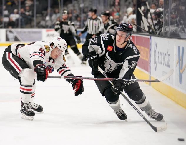 Bobby MacIntyre of the San Antonio Rampage (right) works down the boards against the Rockford IceHogs' Darren Raddysh