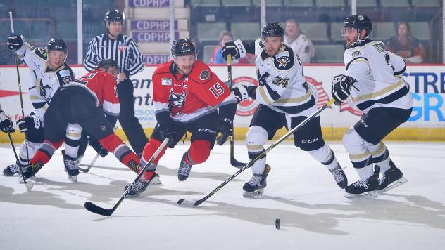 James Henry of the Adirondack Thunder (15) eyes a loose puck against the Wheeling Nailers