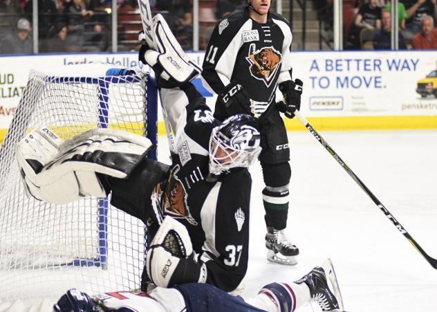 Utah Grizzlies goaltender Kevin Carr gets bowled over against the Tulsa Oilers