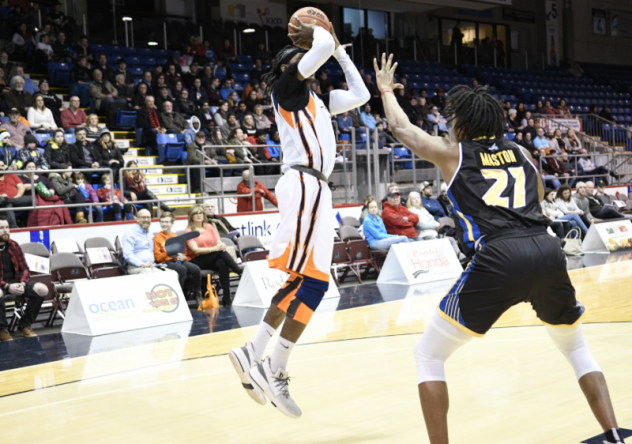 T.J. Mason of the Saint John Riptide defends against the Island Storm