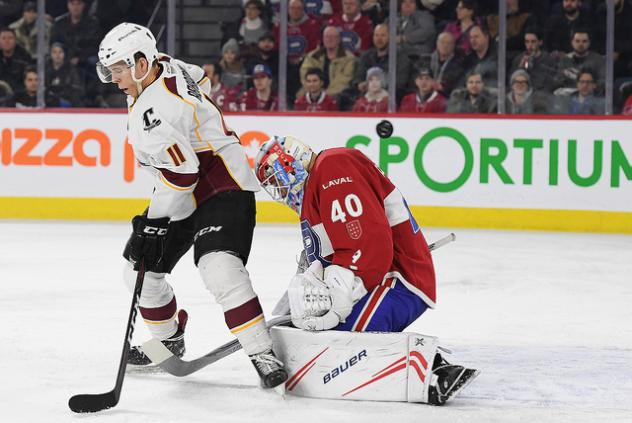 Cleveland Monsters right wing Vitaly Abramov and Laval Rocket goaltender Michael McNiven