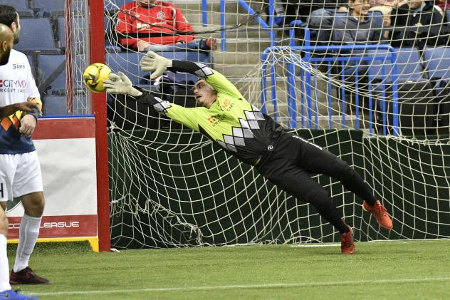 Tacoma Stars goalkeeper Mike Agruello dives for an Ontario Fury shot attempt