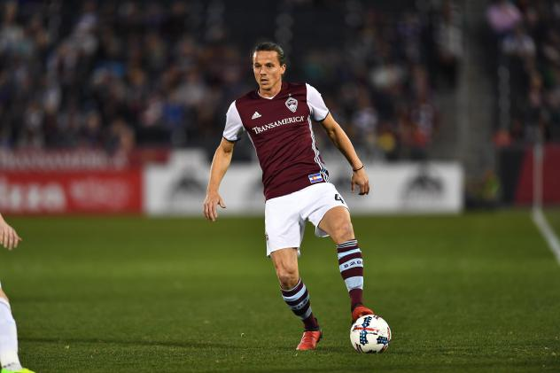 Defender Marc Burch with possession for the Colorado Rapids
