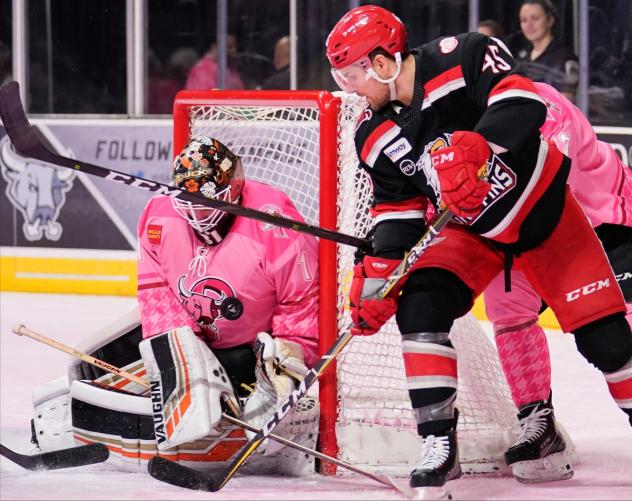 Grand Rapids Griffins right wing Colin Campbell tries to squeeze the puck past San Antonio Rampage goaltender Jared Coreau
