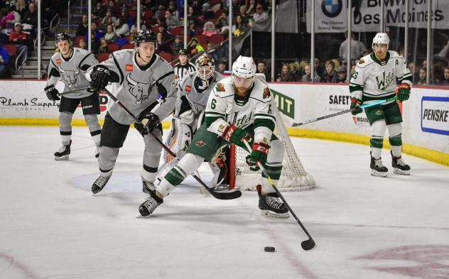 Niko Mikkola of the San Antonio Rampage defends against the Iowa Wild's Mitch McLain