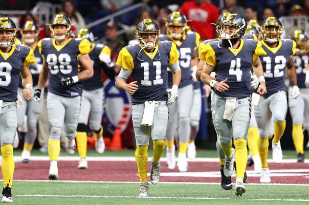 QB Mike Bercovici (11) leads the San Diego Fleet onto the field for its first game