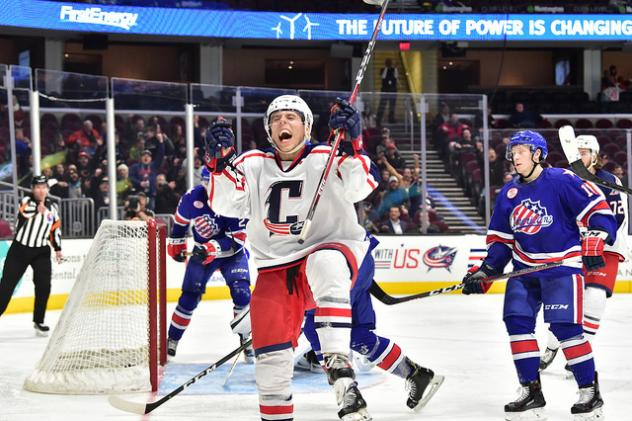 Cleveland Monsters react after a goal against the Rochester Americans
