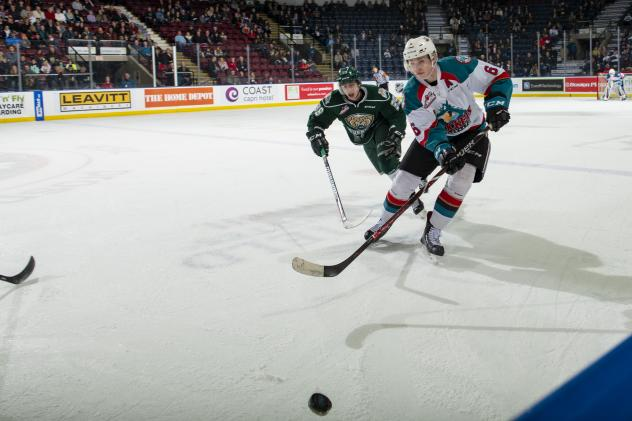 Kelowna Rockets defenceman Kaedan Korczak races to the puck against the Everett Silvertips