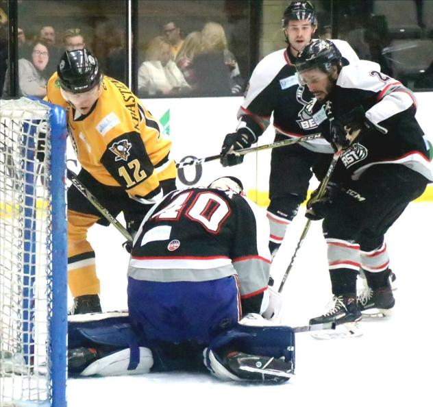 Wheeling Nailers forward Renars Krastenbergs tests the Brampton Beast defense