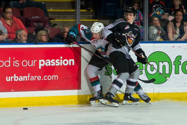 Vancouver Giants right wing Davis Koch pins a Kelowna Rocket against the boards