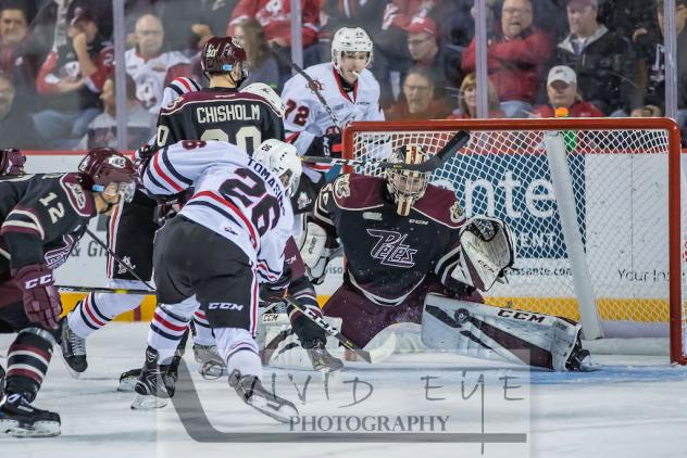 Philip Tomasino of the Niagara IceDogs takes a shot against the Peterborough Petes