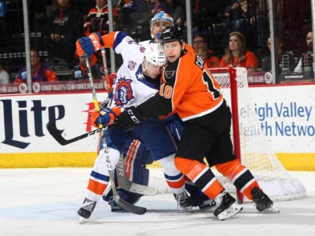 Lehigh Valley Phantoms left wing Greg Carey muscles in against the Bridgeport Sound Tigers
