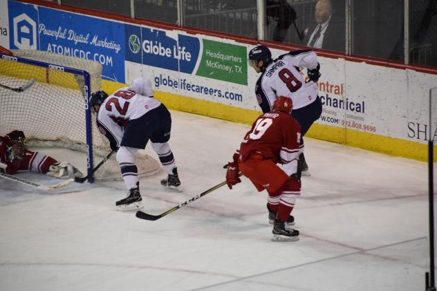 Braylon Shmyr of the Allen Americans (right in red) tries to help out this goaltender