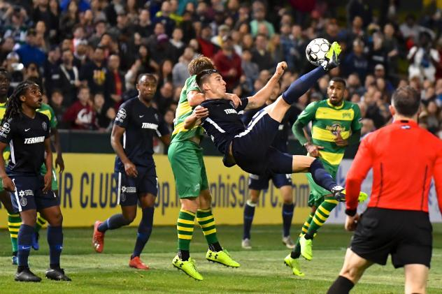 Memphis 901 FC goes airborne for a ball vs. the Tampa Bay Rowdies