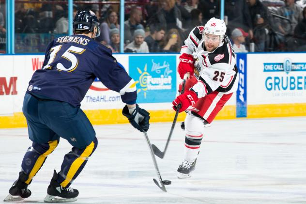 Grand Rapids Griffins left wing Chris Terry (right) vs. the Milwaukee Admirals
