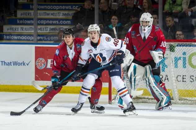 Kelowna Rockets in their Don Cherry jerseys try to keep the Kamloops Blazers at bay