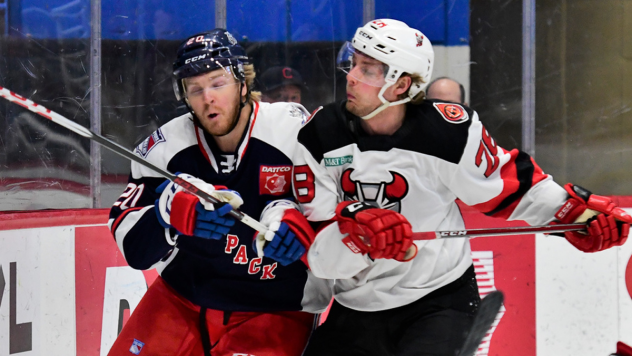 Binghamton Devils left wing Brandon Gignac (right) against the Hartford Wolf Pack