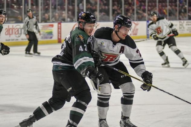 Utah Grizzlies forward Mike Economos (left) vs. the Rapid City Rush