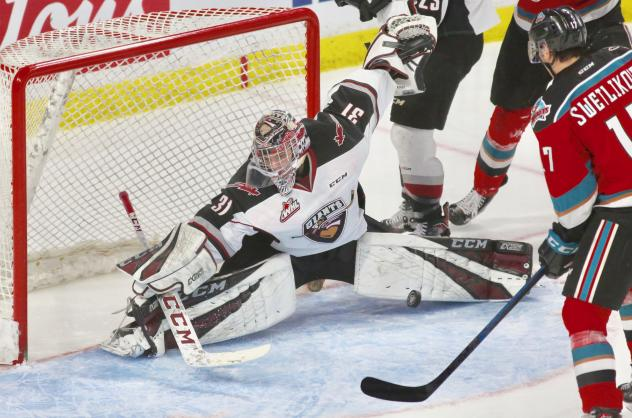 Vancouver Giants goaltender Trent Miner stretches to make a stop against the Kelowna Rockets