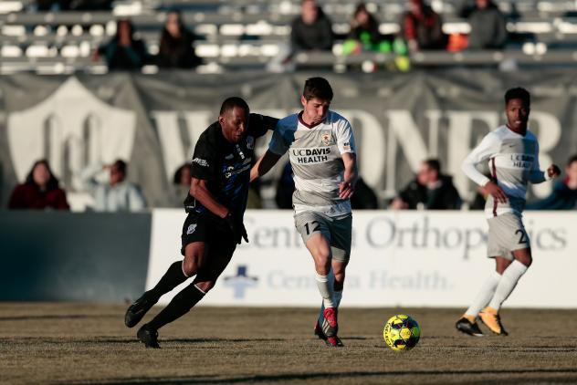Sacramento Republic FC midfielder Drew Skundrich (right) with possession against the Colorado Springs Switchbacks