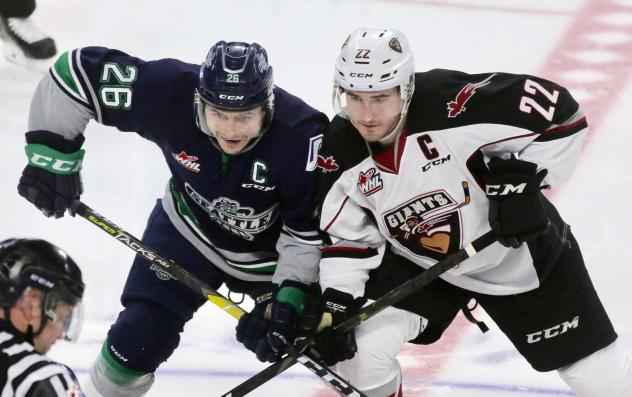 Vancouver Giants right wing Jared Dmytriw (right) faces off with the Seattle Thunderbirds