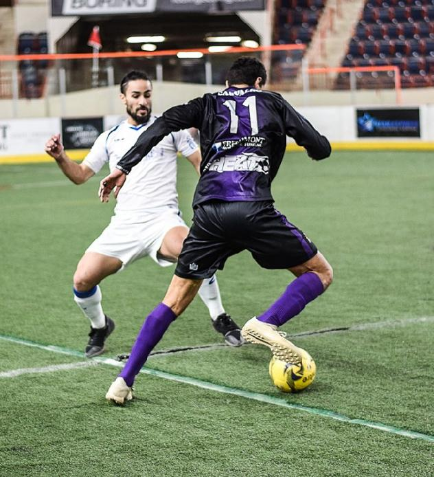 Mississauga MetroStars' Mo Babouli (white) in action last week vs Harrisburg Heat's Ricardo Carvalho