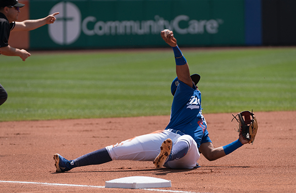 Cristian Santana makes the throw to first for the out after snagging a sharp ground ball in the Tulsa Drillers 3-2 victory over the Arkansas Travelers