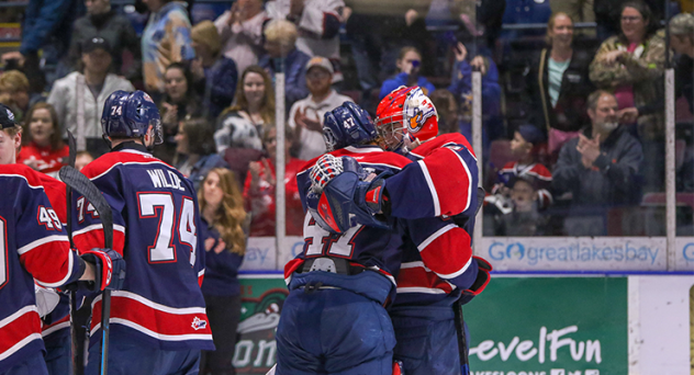 Saginaw Spirit exchange congratulations after a dominant win