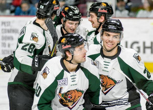 Utah Grizzlies offer congratulations following a goal