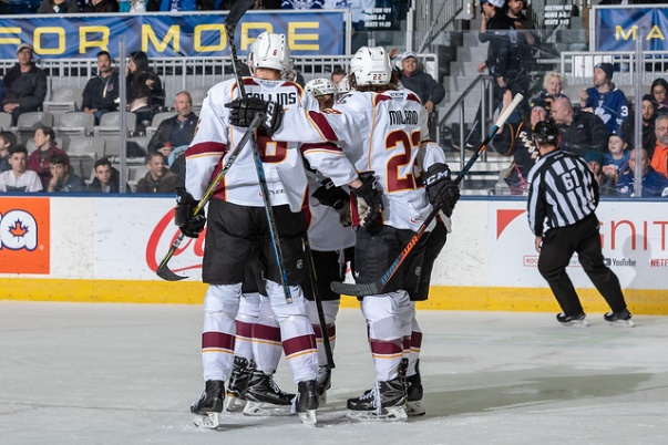 Cleveland Monsters exchange congratulations after a score