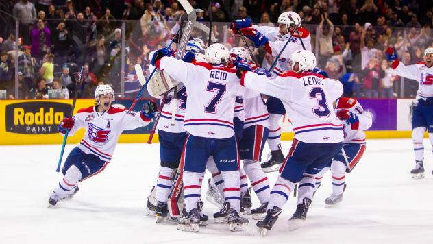 Spokane Chiefs celebrate after advancing past the Everett Silvertips
