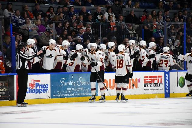 Cleveland Monsters exchange congratulations with the bench following a score