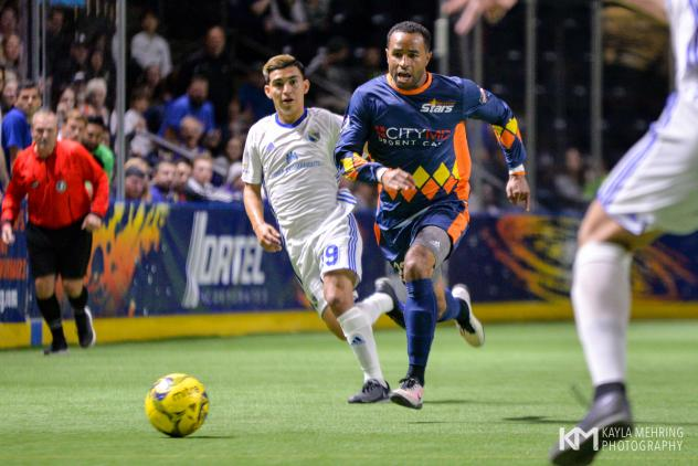 Tacoma Stars and San Diego Sockers race for the ball