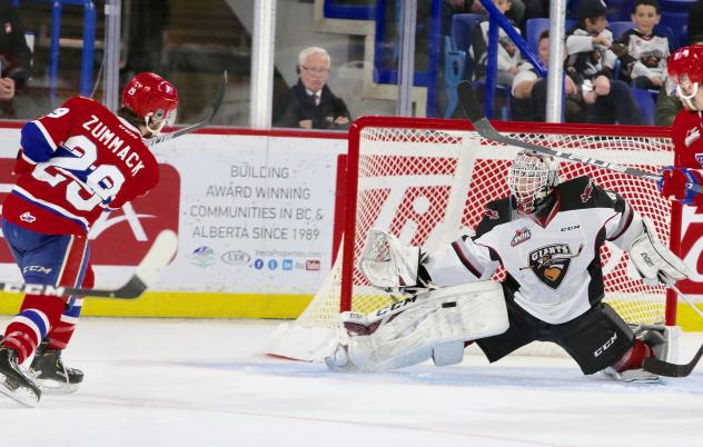 Vancouver Giants goaltender David Tendeck saves a shot by the Spokane Chiefs