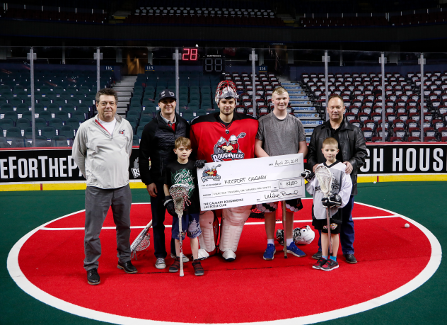 Roughnecks and Ascent Consulting Ltd. Direct present check for $14,180 to KidSport Calgary