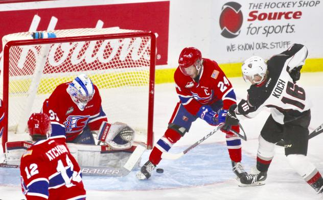 Davis Koch of the Vancouver Giants takes a shot against the Spokane Chiefs