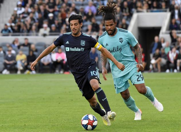 LAFC's Carlos Vela (L) and Seattle's Roman Torres (R)