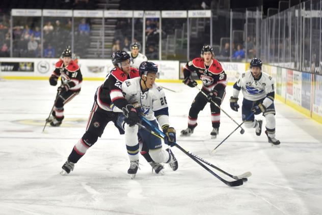 Sioux Falls Stampede forward Andre Lee handles the puck against the Waterloo Black Hawks