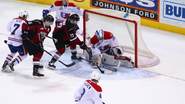 Vancouver Giants right wing Jared Dmitriw (22) shoots against the Spokane Chiefs