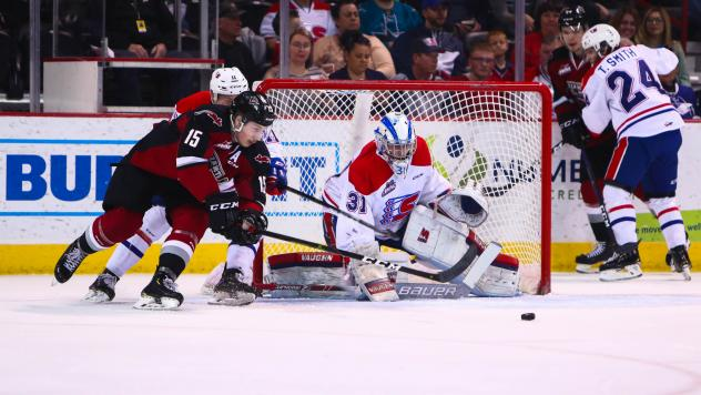 Vancouver Giants right left wing Owen Hardy in front of the Spokane Chiefs net