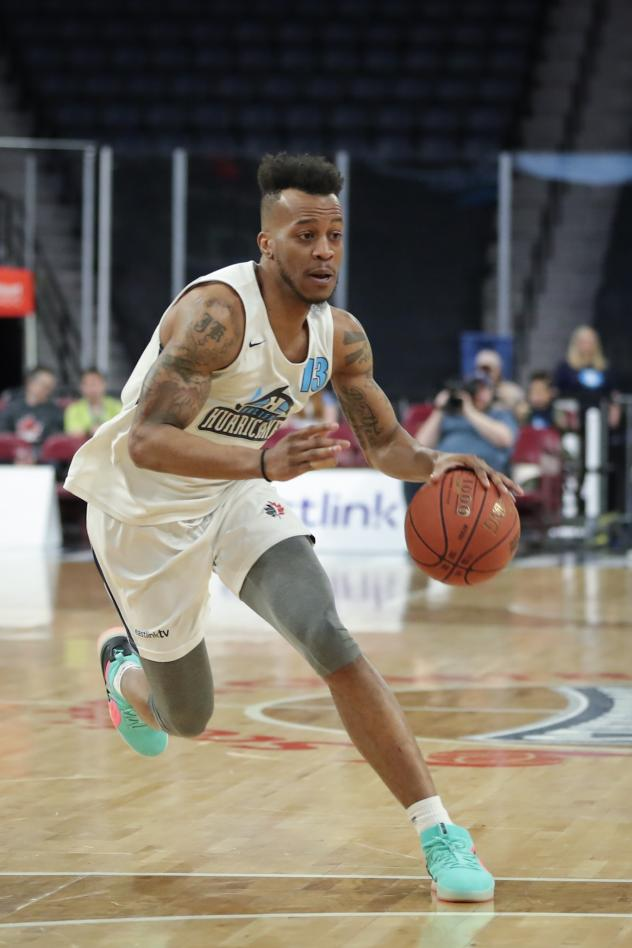 Halifax Hurricanes guard Joel Kindred drives against the Moncton Magic