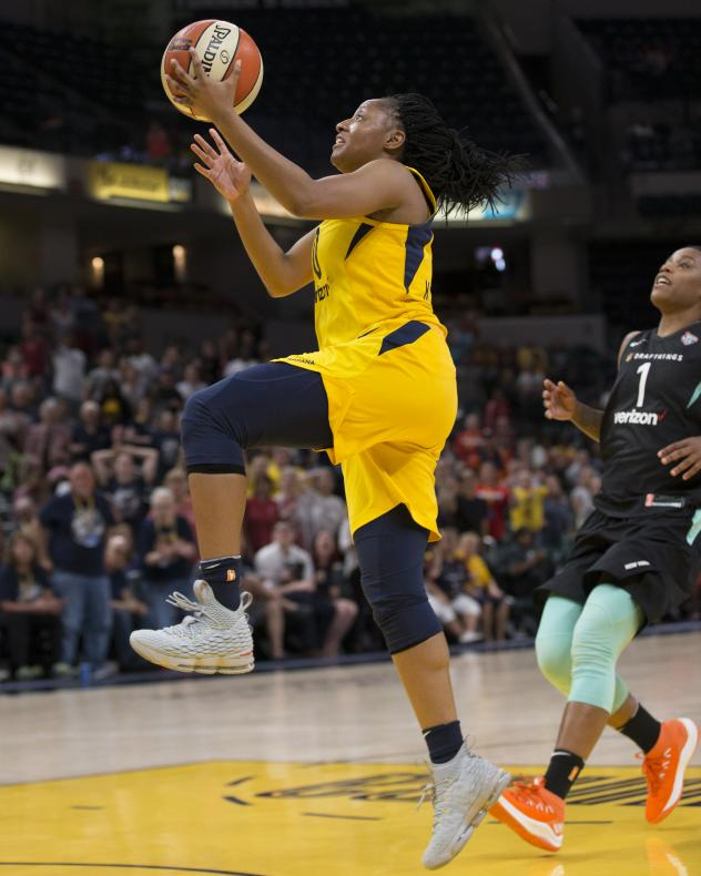 Kelsey Mitchell of the Indiana Fever drives to the basket