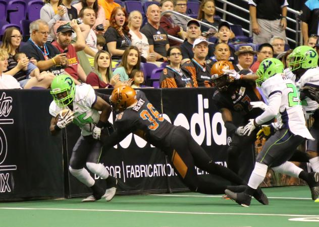 Phillip Henry of the Arizona Rattlers makes a tackle against the boards vs. the Nebraska Danger