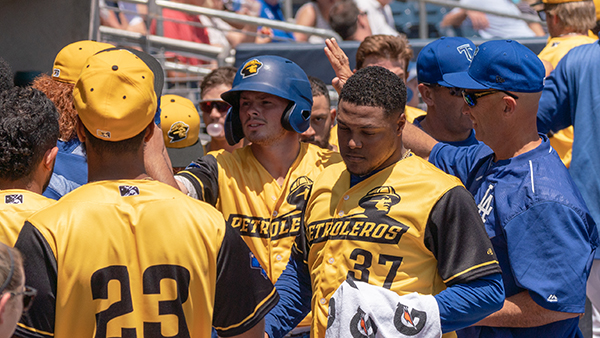 Gavin Lux celebrates with his teammates after homering in the Tulsa Drillers 9-8 victory over the Corpus Christi Hooks on Sunday afternoon