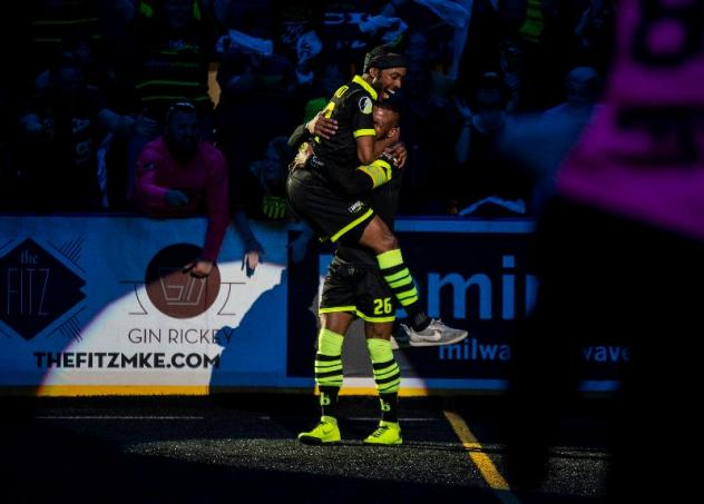 Milwaukee Wave forwards Max Ferdinand and Ian Bennett celebrate a goal against the Monterrey Flash