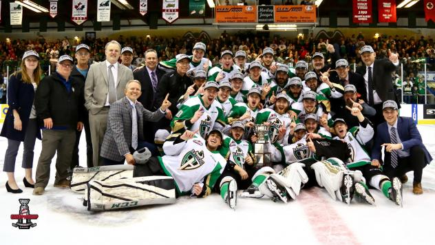 Prince Albert Raiders pose with the Ed Chynoweth Cup after winning the WHL Championship