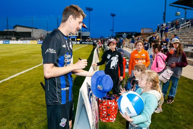 Colorado Springs Switchbacks FC sign autographs for young fans