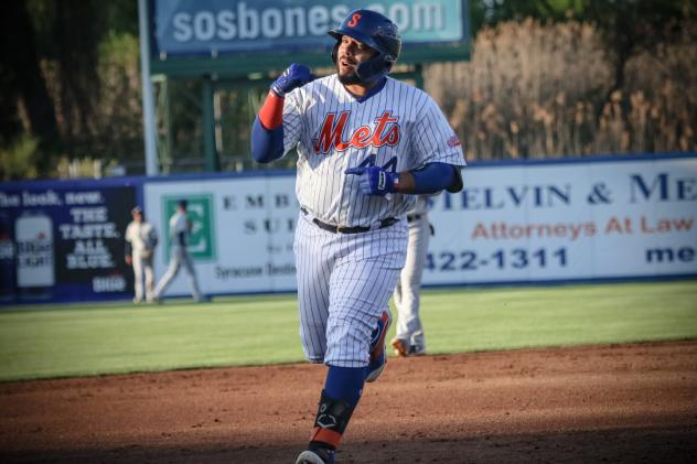 Rene Rivera of the Syracuse Mets rounds the bases after hitting his first of two home runs on Friday night