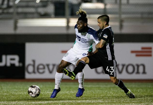 OKC Energy FC forward Omar Gordon (left)