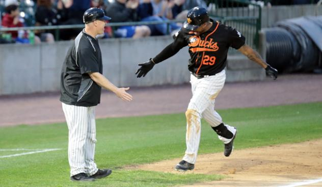 Daniel Fields gets a low five from Long Island Ducks player/coach Lew Ford